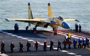 Neighbors wary as China lands fighter jet on its first aircraft carrier