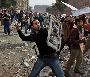Clashes as tens of thousands flood Tahrir Square to mark Egypt revolt